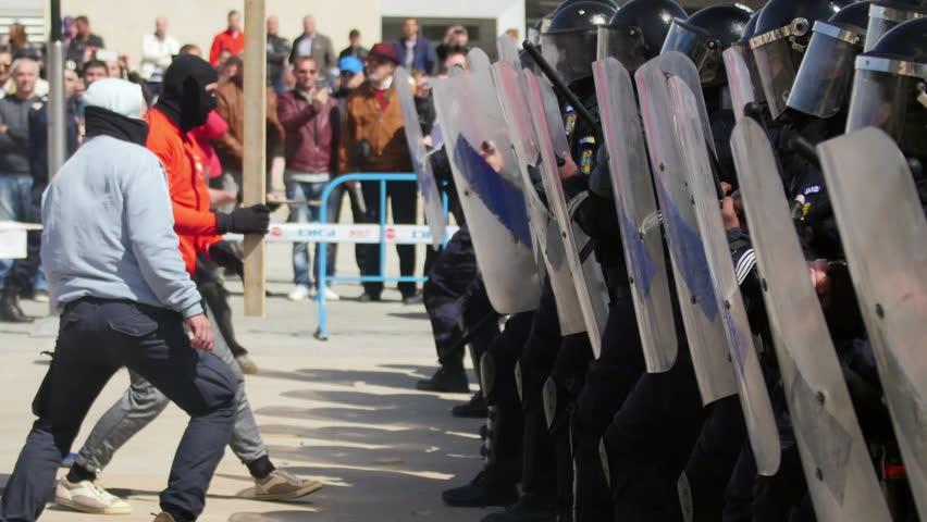 TULCEA, ROMANIA - APRIL 28: Protesters clash with riot gendarmerie during a riot-control exercise on April 28, 2017 in Tulcea, Romania