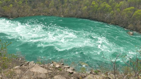 Niagara Whirlpool, a natural whirlpool along the Niagara River located along the Canada–US border between New York and Ontario. Located in the Niagara Gorge, downstream from Niagara Falls.