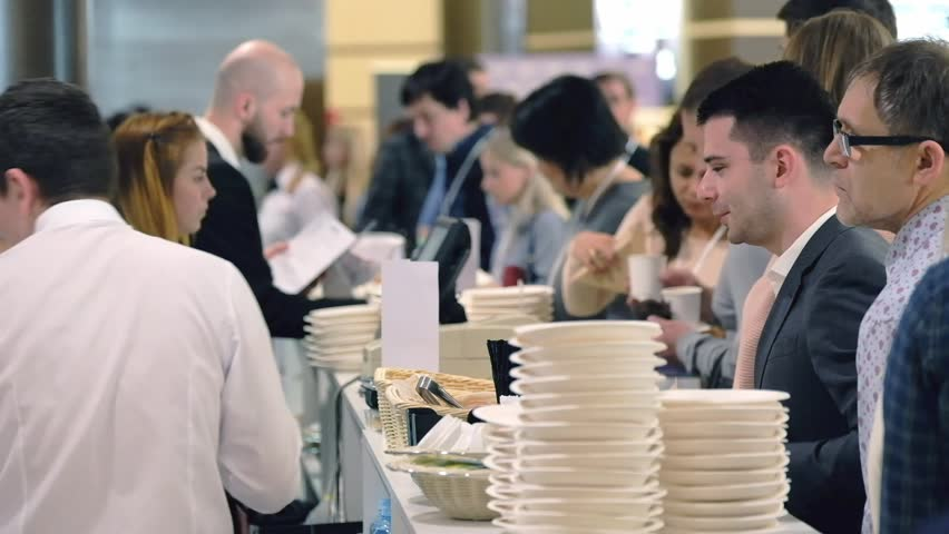 Moscow, Russia - April 24, 2017: Visitors order lunch in a cafe at coffee break at Synergy Global Forum at Crocus Expo Hall. This is one of the largest business forums with more than 5000 participants | Shutterstock HD Video #26405564