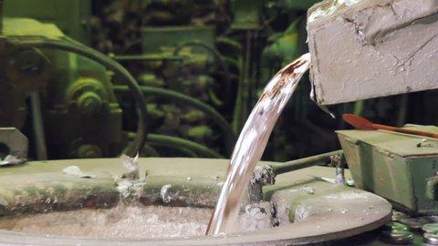 liquid aluminium is overflowing, close-up, in Metallurgical plant, Car factory