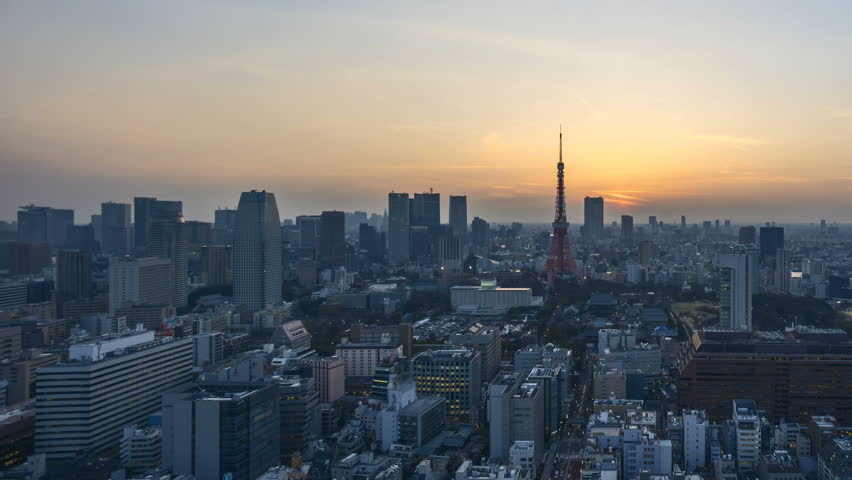 4k time lapse of night to day sunrise scene at Tokyo city skyline with Tokyo Tower. Pan right | Shutterstock HD Video #26419391