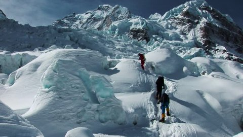 Hikers and sherpas climb/trek their way to the summit of Mount Everest, Himalayas, Nepal.