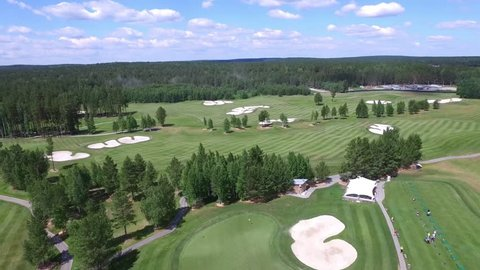 Aerial Golf course with gorgeous green and sand bunker. Aerial view on Golf course with gorgeous green and pond. Golf ball on the beautiful course with sandbanks. Golf course empty view from the sky.