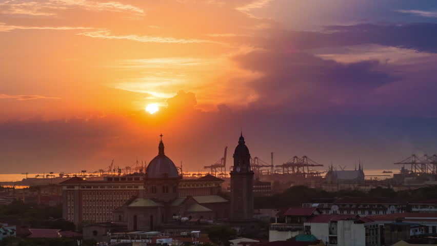 Time lapse view of sunset over the Manila Cathedral in Intramuros, Metro Manila, Philippines - zoom out.
