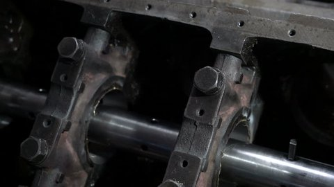 Mechanic measures the inner surface of the engine block with a micrometer. Cylinder block bore.