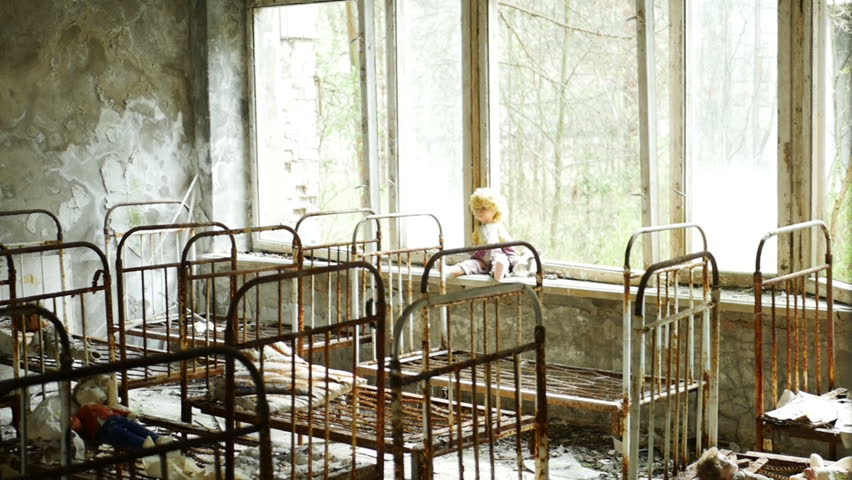 Children's beds in kindergarten of a ruined house in the abandoned city of Pripyat after the tragedy at the Chernobyl nuclear power plant. Conceptual video about child missing or kidnapping