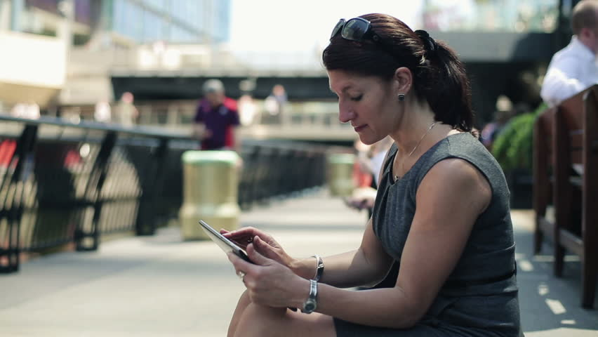Young businesswoman with tablet computer in the city