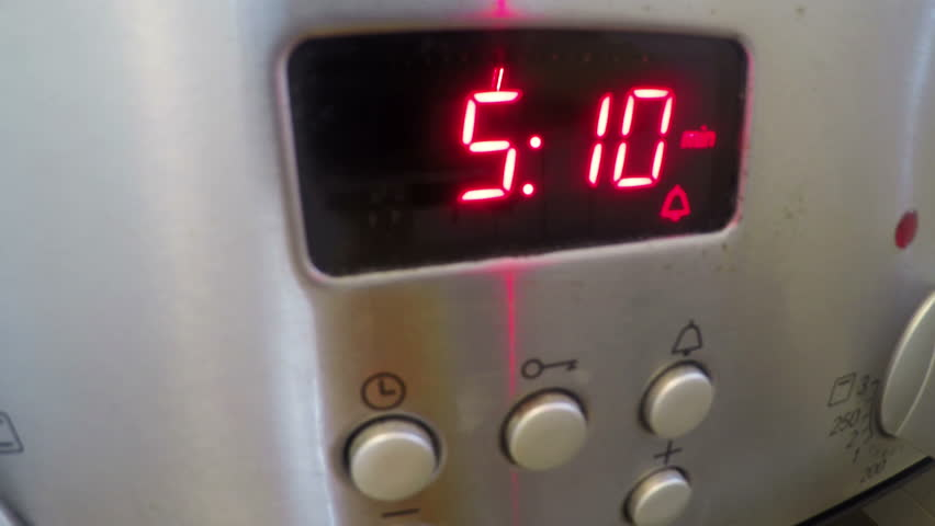 Timer in the kitchen at oven.Time-lapse. | Shutterstock HD Video #26605676