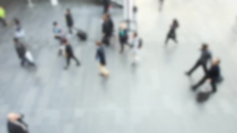 Commuters walking, panoramic view. Video with an intentional blur effect applied. Location and humans not recognizable.