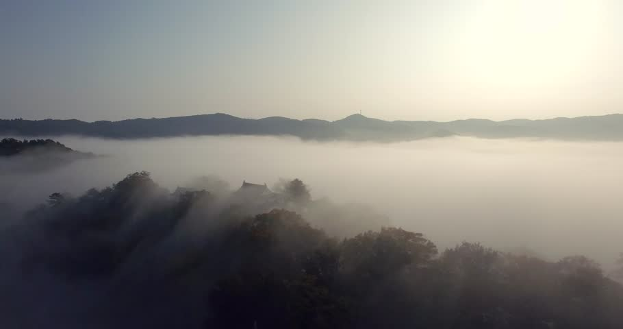 Bitchu Matsuyama Castle in Japan as a sea of clouds blanket surround the castle like an ocean. This video catches the harmonious balance of nature and Japan's historical castle in the sky.