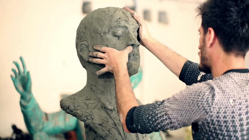 Sculptor is working on the creation of a monument