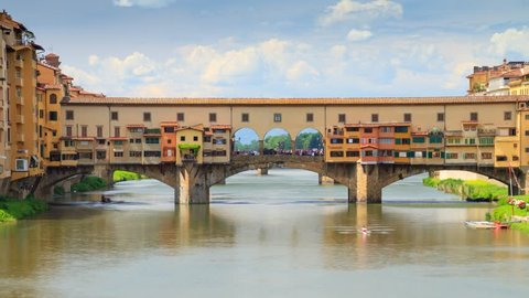 "Time-lapse of old bridge "" Ponte Vecchio "" over the Arno River in Florence, a iconic tourist destination of Europe, Italy"