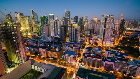Makati, Philippines - May 8, 2017: Makati Timelapse showing city streets and skyway traffic on Ayala avenue in the Central business district skyline at night