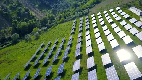 Solar panels farm field of green renewable energy on the italian hills.