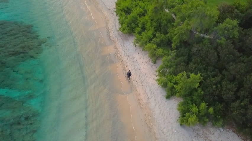 Aerial video shot by a drone of a turquoise sea in Italy. Beautiful beach of the Emerald coast in Sardinia.