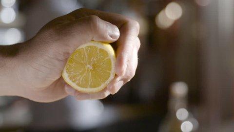 squeezing lemon juice slow mo