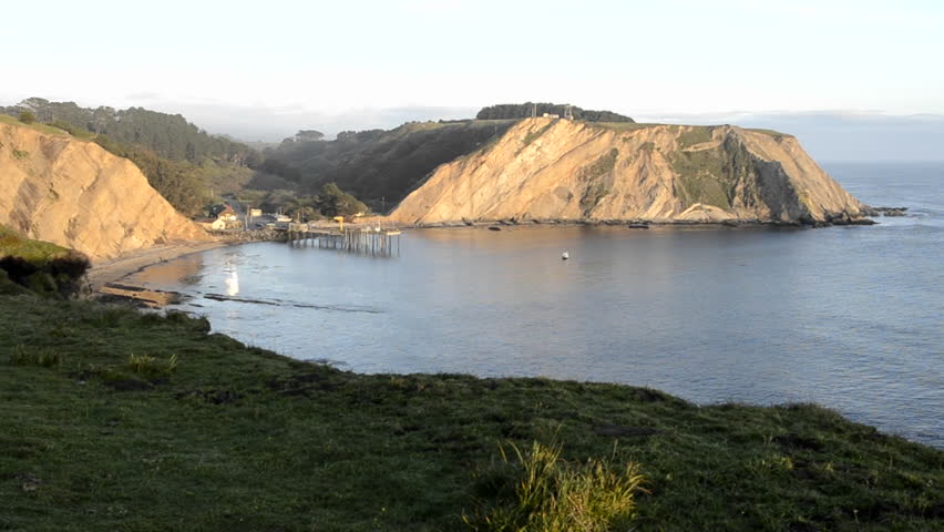 POINT ARENA, CALIFORNIA-CIRCA 2011-Sunset on Arena Cove from the Cypress Abbey County property at Point Arena, California.
