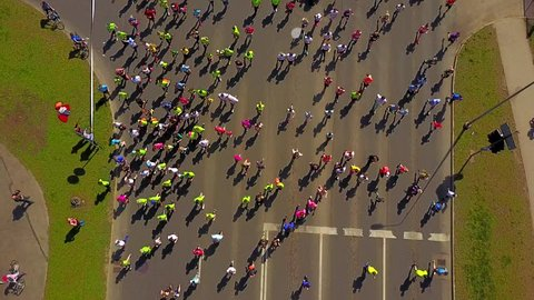 Aerial view of the people running the marathon down the city streets.