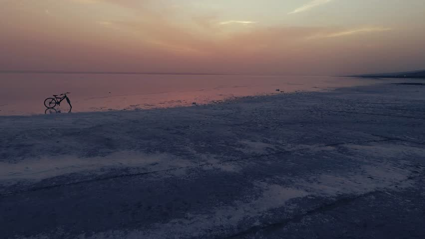 Sunset at salt lake Turkey. sunrise reflection on salt flat covered with water and clouds