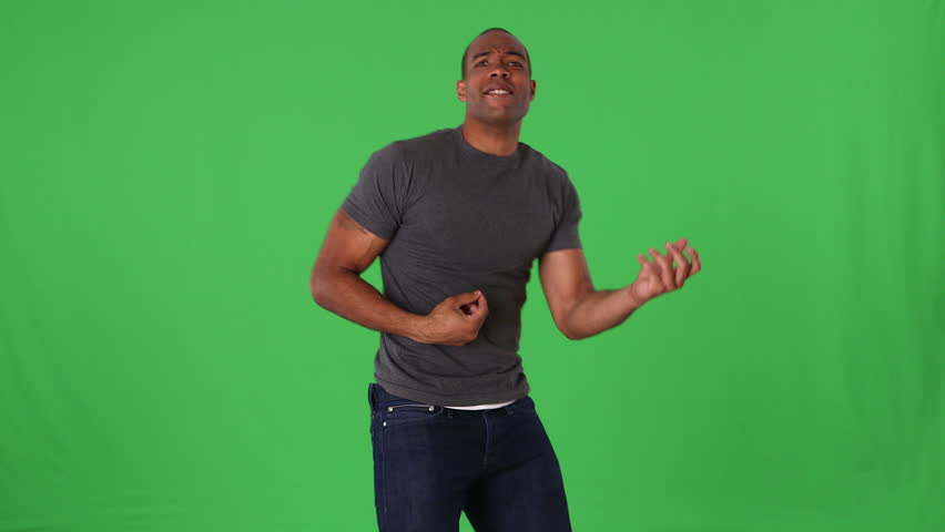 Young man in jeans and t-shirt dancing