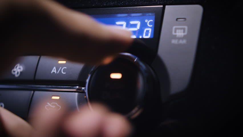 Car Air Conditioning.  Beautiful close up shot of adjusting the AC of a car. With LED display. | Shutterstock HD Video #26868388