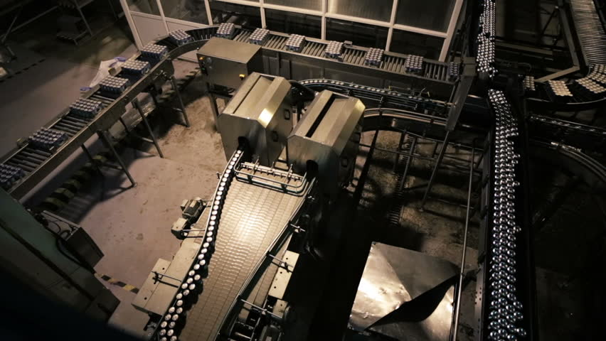 Conveyor for the production of drinks in aluminum cans