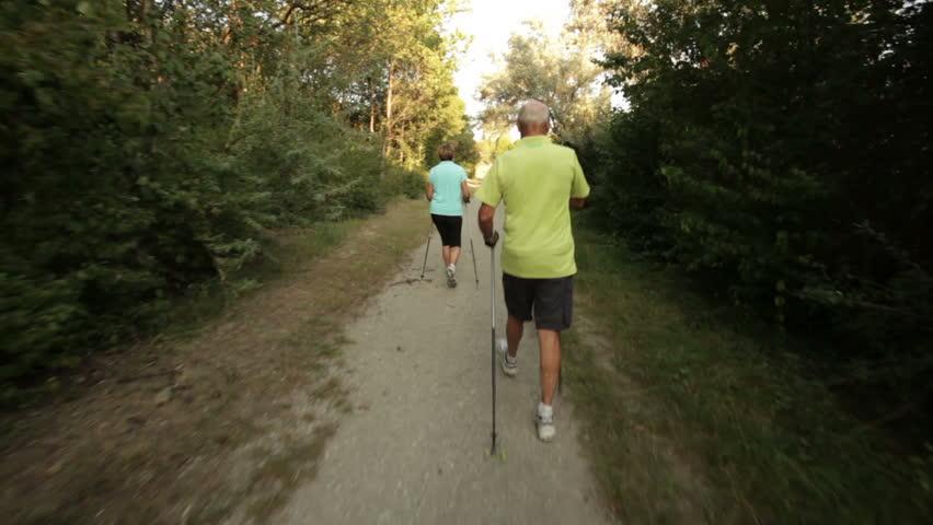 Following nordic walkers in park  | Shutterstock HD Video #2687375