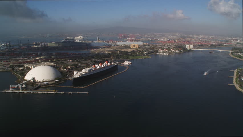 Flying past the Queen Mary moored in Los Angles Harbor at Long Beach, California. Shot in 2010. | Shutterstock HD Video #26874658