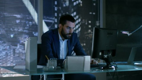 Late at Night Businessman Looses Temper Throws Everything Of His Table. He Works in a Private Office with Big City Window View.