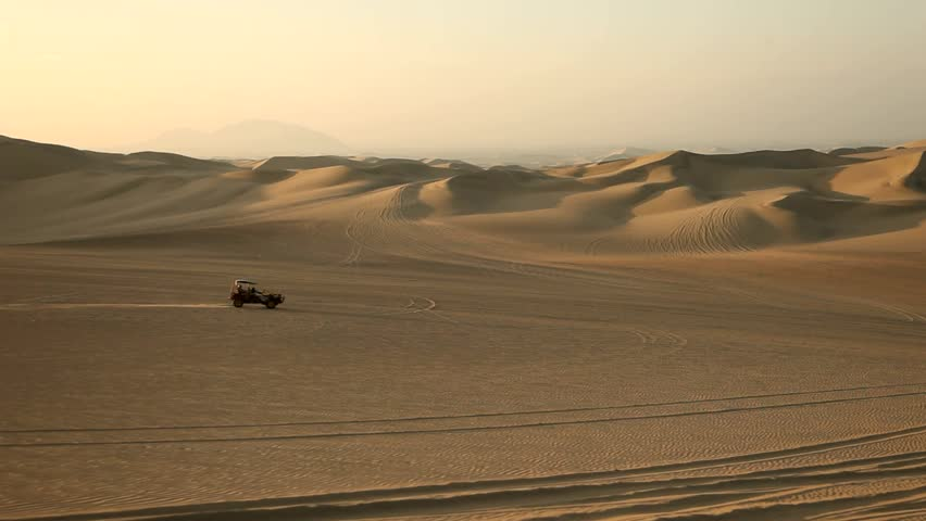 footage of driving with a buggy off-road in the dunes of Ica, Peru