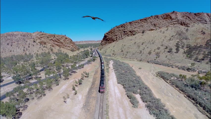 Aerial Drone Shot of Alice Springs Train Arriving, Canyon, Eagle Bird Desert Australia Red Centre