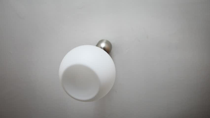 Noisy neighbors - swinging chandelier on the ceiling #26924398