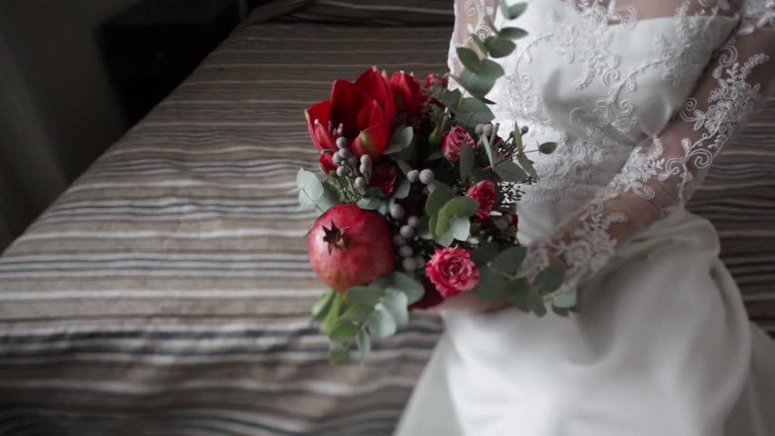 Beautiful bride's bouquet. Red flowers. Bride holding a bouquet. Wedding bouquet with garnet. | Shutterstock HD Video #26938855