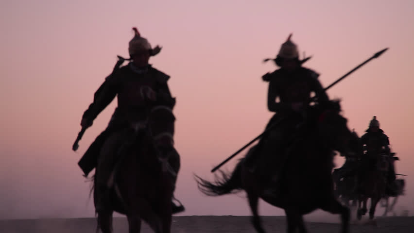 Horsemen warriors silhouetted, Medieval Cavalry attacks the Enemy | Shutterstock HD Video #26946628