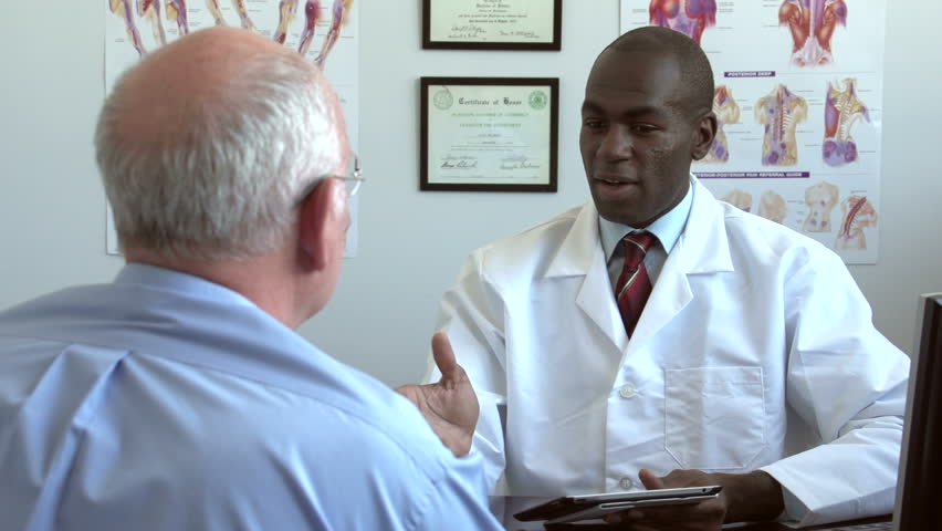 Doctor meeting with patient, using tablet | Shutterstock HD Video #2700938