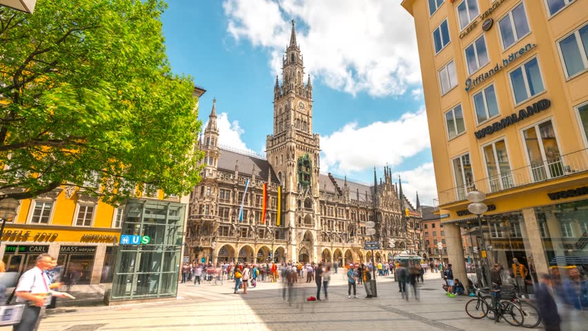 Munich, Germany - May 22, 2017: Moving Hyperlapse video in front of City Hall at Marienplatz square in 4K, Munich Bayern, Germany. Mary's public square Munich and New town hall in sunny day