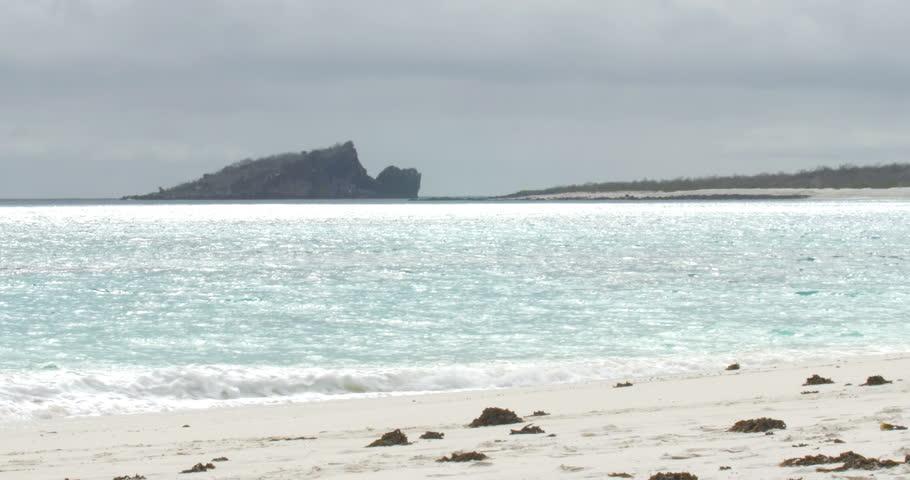 Sailing close to Galapagos island rocks
