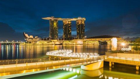 Singapore City, Singapore - 22 January, 2017: Singapore Marina Bay Sands and Merlion Night to day timelapse, Singapore 4K Time lapse