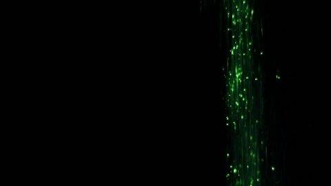 Green glitter, falling down, on black background Fairy magic dust, or unicorn fart :-D