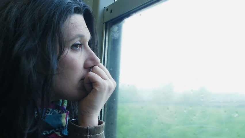 Sad girl looking out window