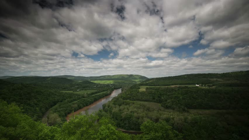 Beautiful time lapse of the view the Appalachian mountains and Potomac River of West Virginia, Pennsylvania, and Maryland as clouds float over the landscape.