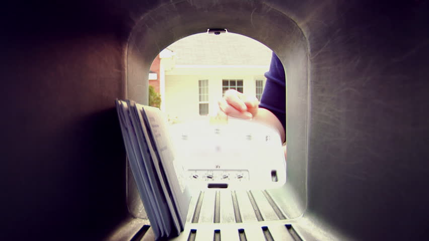 A POV shot of someone taking letters and mail out of the mailbox 1080 HD video | Shutterstock HD Video #2706647