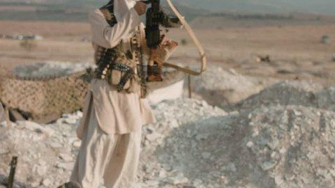 Armed mujahid in the field