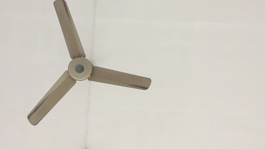 Top view slow motion video of screw spinning small dji phantom the ceiling fan gradually rotates the rotor because of the wind force hd stock mozeypictures Images
