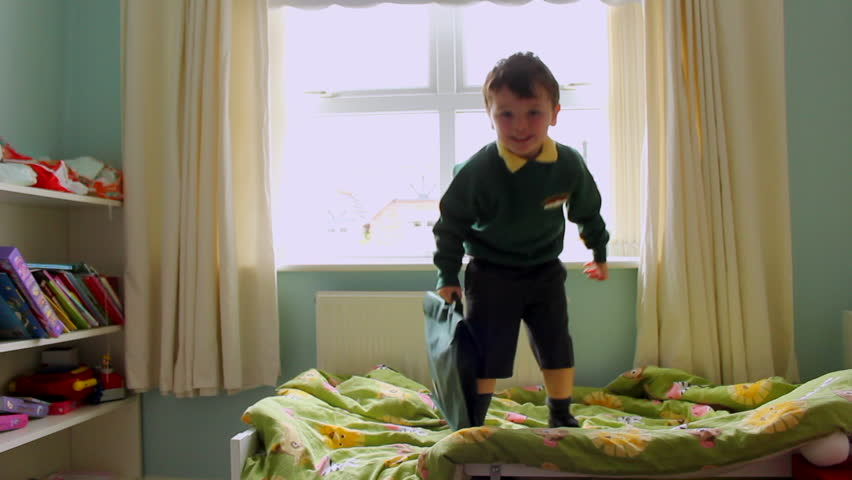 Children jumping on bed with school uniform getting ready for first day back at school | Shutterstock HD Video #27096538