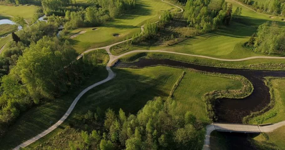 Aerial landscape flight over golf course