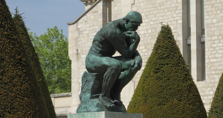 PARIS, FRANCE - MARCH 25, 2017: Rodin's sculpture THE THINKER, reveal from garden