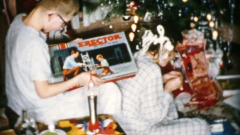 CLEVELAND, OHIO, DECEMBER, 1956: A young teenage boy gets a brand new Erector Set for Christmas in Cleveland, Ohio in 1956.