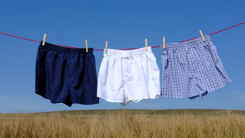 Three pairs of boxer shorts drying on a washing line in an unusual outdoor location. | Shutterstock HD Video #27208978