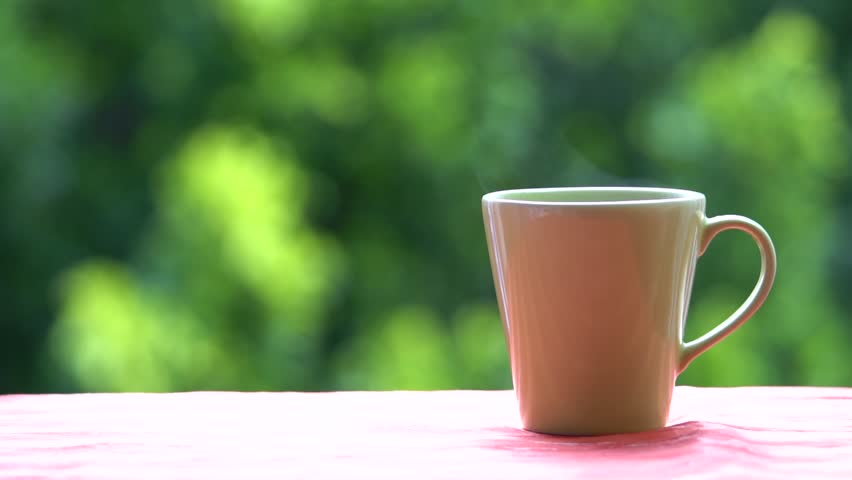 Close-up of man s hand holding a cup of coffee,  | Shutterstock HD Video #27229978